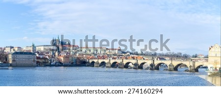 famous view of the prague castle and the charles bridge in prague which every year attracts milions of tourists from all around the world. - stock photo