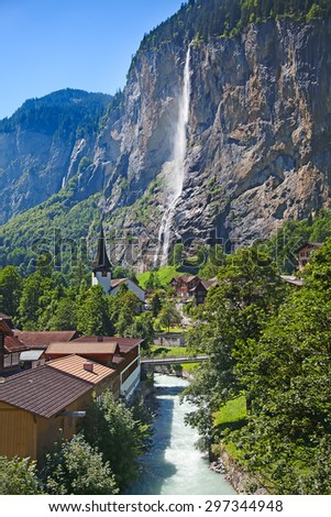 Famous village Lauterbrunnen in swiss alps - starting point for train tours in the Jungfrau region - stock photo