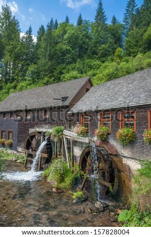 famous Watermill in Black Forest called Hexenlochmuehle near Furtwangen,Black Forest,Germany - stock photo