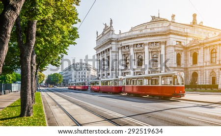 Famous Wiener Ringstrasse with historic Burgtheater (Imperial Court Theatre) and traditional red electric tram at sunrise with retro vintage Instagram style filter effect in Vienna, Austria - stock photo
