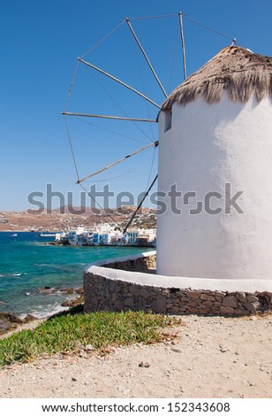 Famous windmill of Mykonos on the background of Little Venice - stock photo