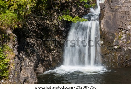 Famous Witch's Cauldron waterfall at the shore of Loch Arkaig, close to Fort William - stock photo