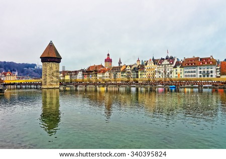 Famous wooden Chapel Bridge in Lucerne, Switzerland. Subsequently restored, the Kapellbrucke is the oldest wooden covered bridge in Europe, as well as the worlds oldest surviving truss bridge - stock photo