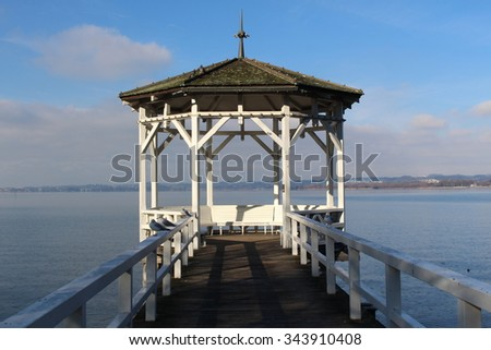 Famous wooden pier gazebo in Lake Constance (Bodensee) in Bregenz,Vorarlberg, Austria. - stock photo
