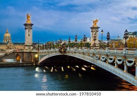 famouse Alexandre III Bridge at night,  Paris, France - stock photo