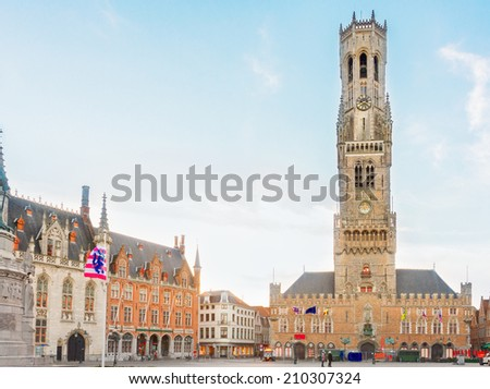 famouse medieval belfry Belfort of Bruges and  Grote Markt square, Belgium - stock photo