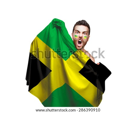Fan holding the flag of Jamaica on white background - stock photo