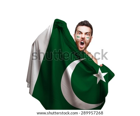 Fan holding the flag of Pakistan on white background - stock photo