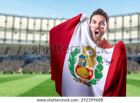 Fan holding the flag of Peru in the stadium - stock photo