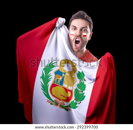 Fan holding the flag of Peru on black background - stock photo