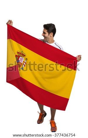 Fan holding the flag of spain celebrates on white background