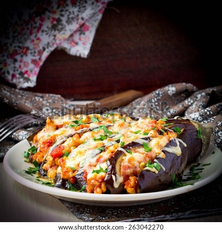 Fan of eggplant, meat stews, tomatoes, cheese, delicious Italian dish - stock photo