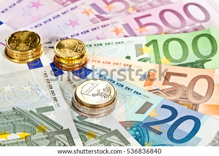 Fan of euro banknotes of different value and euro coins