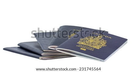 Fan of new and old Canadian passports isolated on white. - stock photo