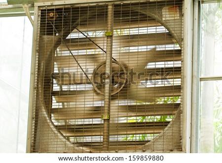 fan on wall - stock photo