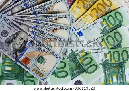 Fan-shaped banknotes, dollar and euro  - stock photo