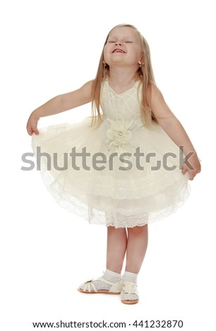 Fancy a little fair-haired girl in a white party dress - Isolated on white background - stock photo