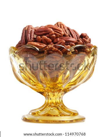 fancy bowl filled with pecans - stock photo