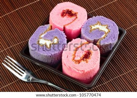 Fancy cake rolls. - stock photo