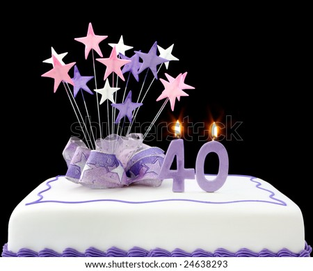 Fancy cake with number 40 candles.  Decorated with ribbons and star-shapes, in pastel tones on black background. - stock photo
