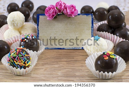 Fancy chocolate candies with greeting card and decorations - stock photo