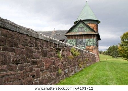 fancy farmhouse and courtyard wall - stock photo