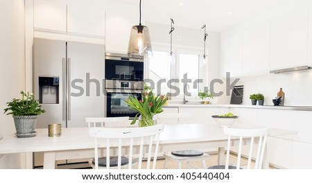 fancy kitchen interior with kitchen table and chairs - stock photo