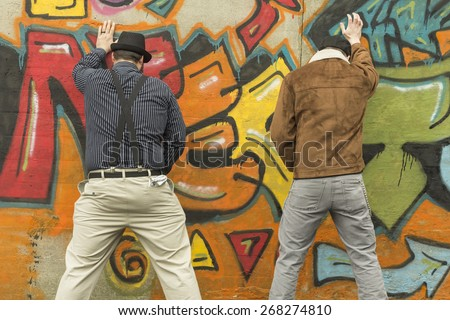 Fancy pals high five as they pass each other - stock photo