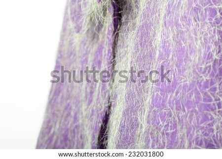 Fancy Purple Fabric with Green Hair - stock photo