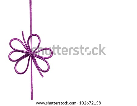 Fancy purple ribbon bow isolated on white background with room for your text - stock photo