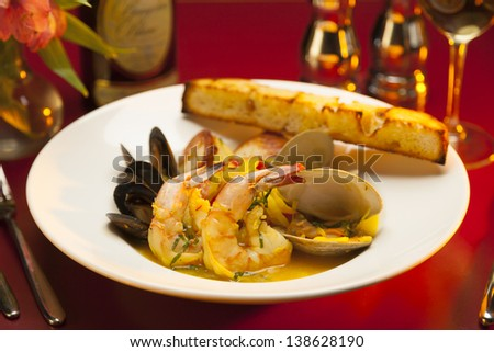 Fancy restaurant seafood appetizer on a white plate with red linen. - stock photo
