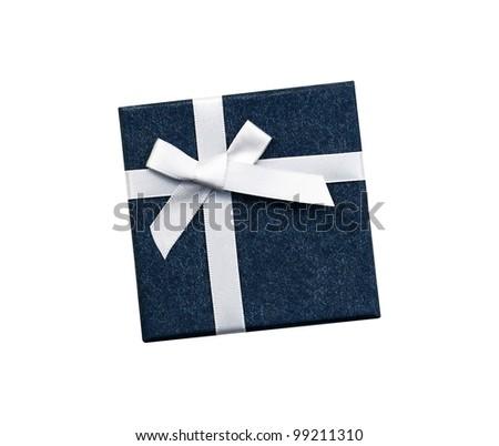 Fancy white ribbon gift bow on blue gift box isolated on white background - stock photo