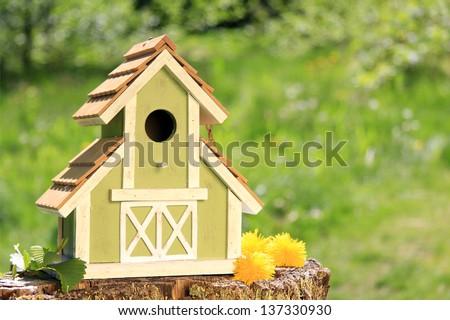 Fancy wooden bird house. - stock photo