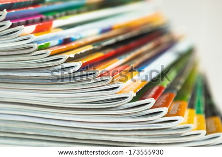 fanned out pile of magazines - stock photo