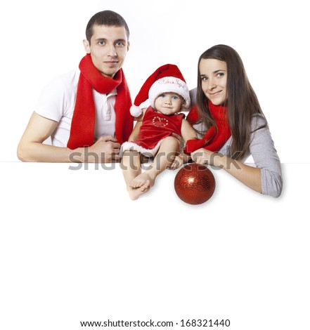 Fanny family in the costumes of Santa Claus posing on a blank on the banner - stock photo