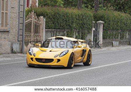 FANO, ITALY - MAY 16: yellow lotus elise old racing car in rally Mille Miglia 201 4 the famous italian historical race (1927-1957) on May 2014