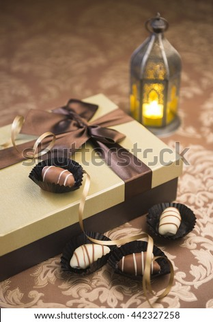 Fanoos, date chocolates and gift box. Delightful Eid celebration. - stock photo