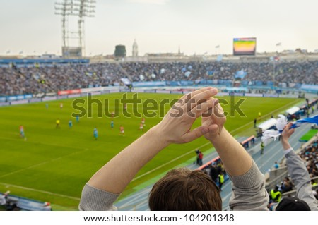 Fans at a stadium. - stock photo