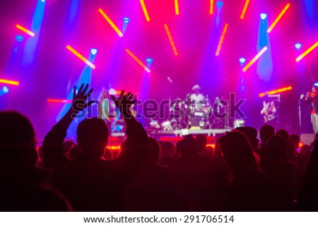 Fans cheering at an open-air live concert. Image not in focus. - stock photo