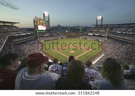 Fans in top row are part of the 29,183 baseball fans at Citizens Bank Park, Philadelphia, PA, watching the Philadelphia Phillies beat the Milwaukee Brewers by a score of 8 to 6 on May 14, 2007 - stock photo