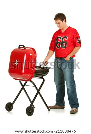 Fans: Man Grilling Before Football Game