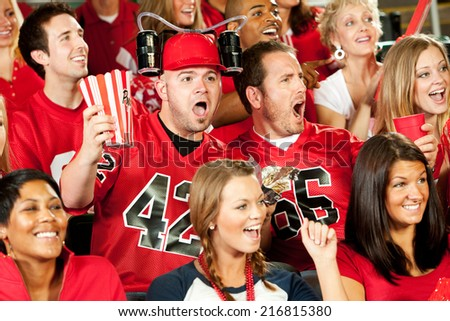 Fans: Man With Beer Hat Cheers For Great Football Play - stock photo