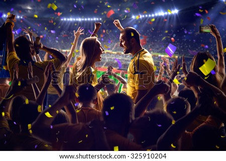 Fans on stadium game  - stock photo