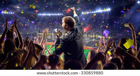 Fans on stadium game businessman - stock photo