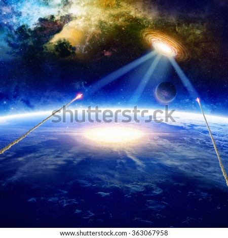Fantastic background - aliens spaceship hits planet Earth, aliens invasion, missile defense. Elements of this image furnished by NASA - stock photo