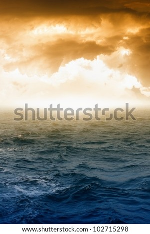 Fantastic background - glowing sky and dark sea - stock photo
