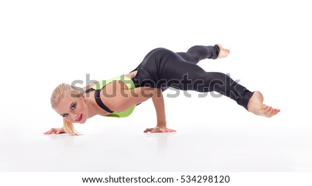 Fantastic balance. Portrait of an attractive professional female gymnast doing a handstand smiling to the camera isolated copyspace balance power strength health sport active concept