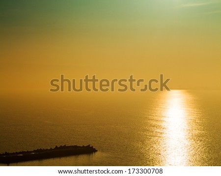 Fantastic beautiful sunset seascape with the horizon line disappears in the fog. Image shows a nice grain pattern at 100 percent - stock photo