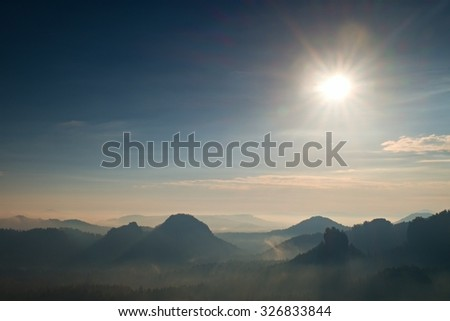 Fantastic dreamy daybreak above peaks of smoky  mountain with the view into misty valley - stock photo