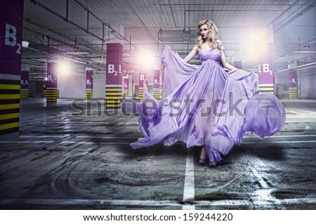 Fantastic fashion woman in fluttering dress  - stock photo